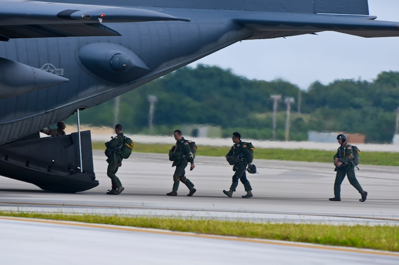 Members of the 736th Security Force Squadron board a C-130 Hercules Aug. 21 for their second jump during static line training on the Andersen Air Force Base, Guam, flightline. Before the flight, the jumpmasters receive a briefing from the aircrew regarding the flight path, different jump scenarios and safety precautions.