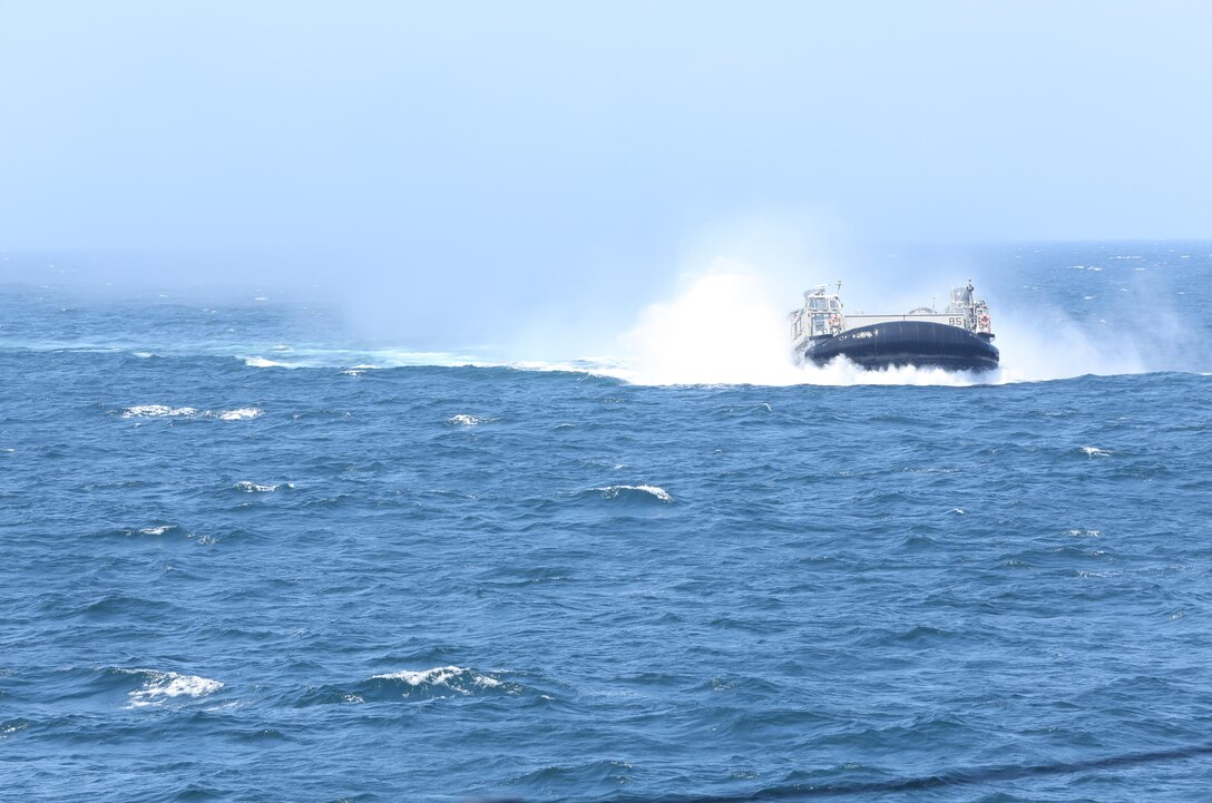 A hovercraft also known as a landing craft air cushion makes its way to the USS Wasp for an amphibious operation training exercise with 3rd Battalion, 8th Marine Regiment, and Mobile Assault Company, 2nd Combat Engineer Battalion, July 24, 2013. The LCACs carried Marines, sailors, vehicles and equipment from sea to shore.
