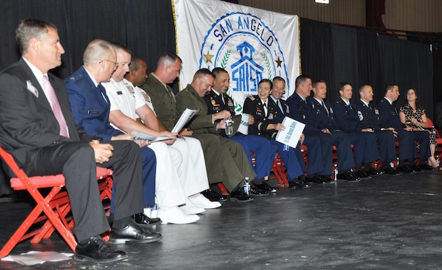 SAN ANGELO, Texas - Goodfellow Air Force Base leadership sits on stage at the Foster Communications Coliseum before the San Angelo Independent School District convocation Aug. 22. The SAISD invited Goodfellow commanders and senior enlisted members to the convocation in support of the relationship between the city of San Angelo and Goodfellow. (U.S. Air Force photo/ Airman 1st Class Joshua Edwards)