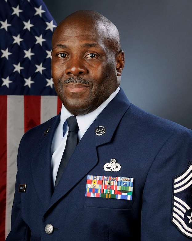 U.S. Air Force Chief Master Sgt. Joseph Brunson, a human resource advisor with Joint Forces Headquadrters at McEntire Joint National Guard Base, South Carolina Air National Guard, poses for his official portrait August 10, 2013.   (U.S. Air National Guard photo by Tech. Sgt. Caycee Watson/Released)
