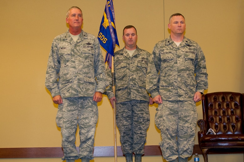745th Special Operations Squadron Chief Maser Sgt. Mike Surles bears the unit's colors during a deactivation ceremony at Hurlburt Field, officiated by Air Force Special Operations Air Warfare Center Commander Brig. Gen. Jon Weeks and 745th SOS commander Lt. Col. Rick Seymour. (U.S. Air Force Photo/Senior Airman Naomi M. Griego)
