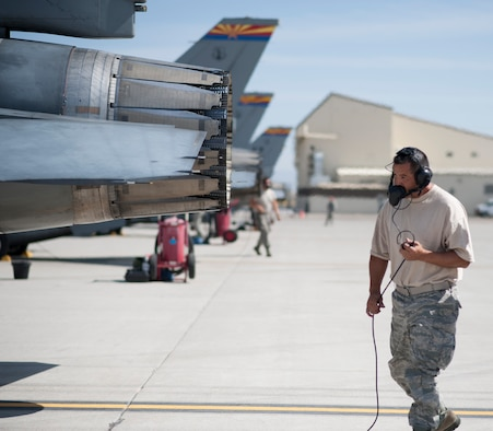 Staff Sgt. William Garcia, 152nd Fighter Squadron crew chief performs pre-flight checks and inspections Aug. 22, 2013, at Mountain Home Air Force Base, Idaho. More than 30 Arizona Air National Guardsman are currently on temporary duty here conducting training.