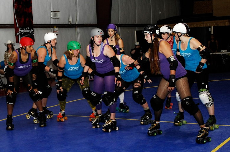 Staff Sgt. Hilary Middleton prepares to start a bout with the Tucson Roller Derby in Tucson, Ariz., August 10, 2013. During a bout, players try to keep members of the opposing team from getting past them and scoring. Middleton is an aircrew flight equipment technician with the 355th Operations Support Squadron.