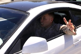 Lance Cpl. Orrin Farmer demonstrates road rage. Road rage is response to what drivers consider poor, inconsiderate or dangeous driving. Photo illustration.
