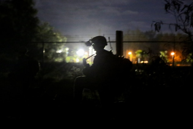 A Marine serving with with Alpha Company, 1st Reconnaissance Battalion, posts security during a night raid for a mission rehearsal exercise here, Aug. 19, 2013. The MRX tested the Marines ability to organize and move within their fire teams while coordinating with their command element.