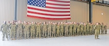 Soldiers of the CAB, 1st Inf. Div. gather in formation after sharing heartfelt goodbyes with their Families during an Aug. 15 deployment ceremony at Marshall Army Airfield.  Photo by: J. Parker Roberts, 1ST INF. DIV.