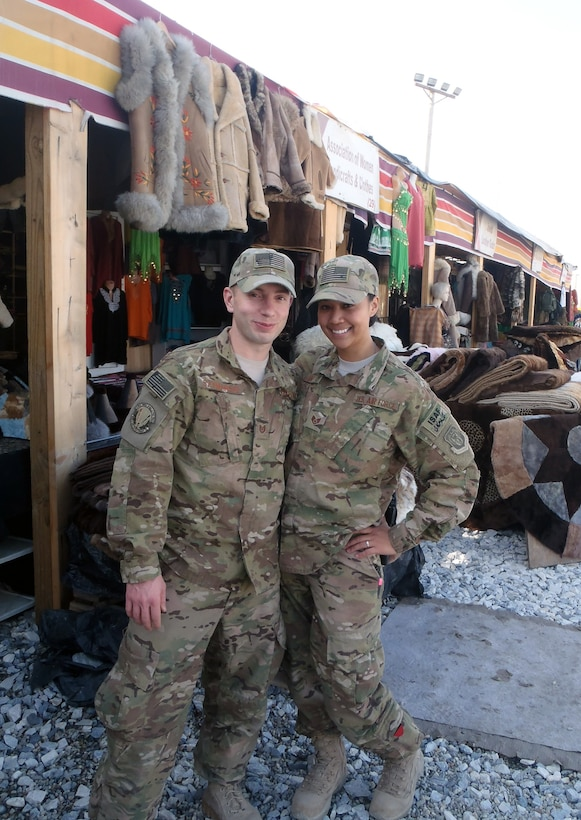 """Tech. Sgt. Tyler Szymanski, or """"Ski,"""" and Staff Sgt. Maria Szymanski, both 366th Surgical Operations Squadron medical technicians, visit a bazaar on Bagram Airfield, Afghanistan. The couple first deployed together in 2011, and again in 2013, and spent one week stationed on BAF together before Ski forward deployed with a Special Forces Operational Detachment Alpha in Kanduz Province, Afghanistan. (Courtesy photo)"""