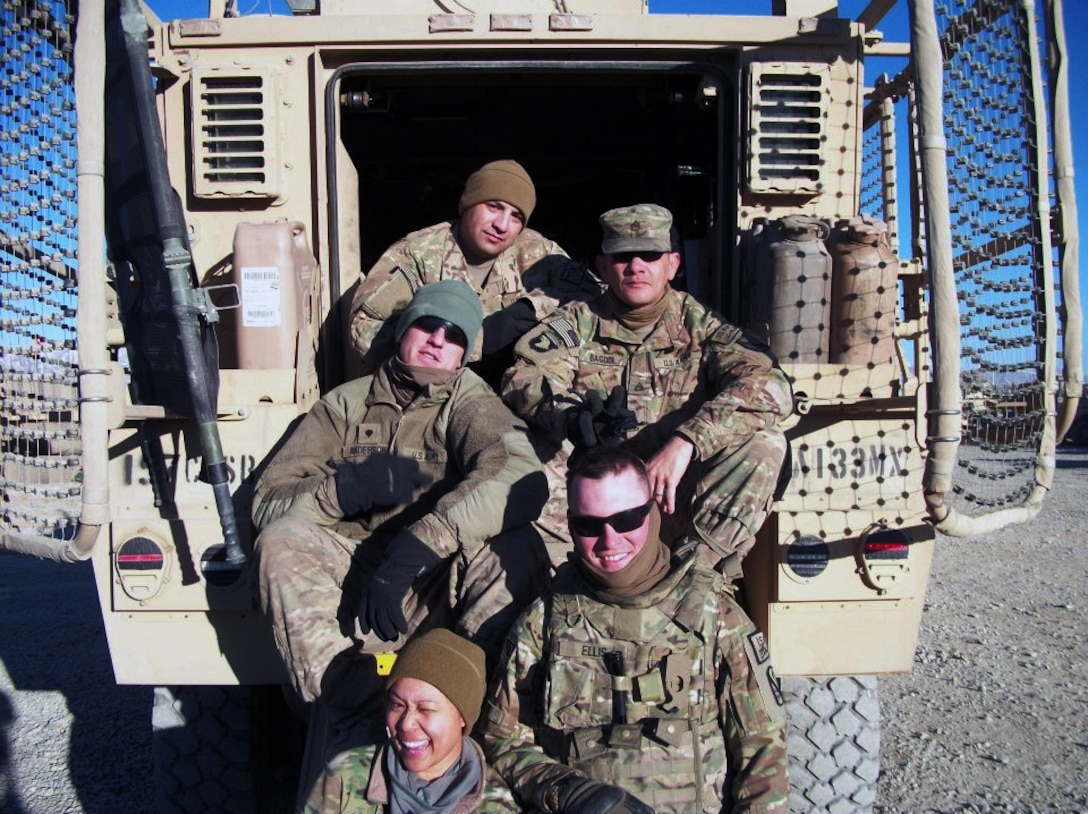 Air Force Staff Sgt. Maria Szymanski, a 366th Surgical Operations Squadron medical technician (bottom), poses with her five-person convoy team before a May 29-30, 2013 convoy from Bagram Airfield, Afghanistan, to forward operating bases and combat outposts in Wardak Province. The next day, during day two of the mission, the vehicle Szymanski was supposed to ride in, struck an improvised explosive device, killing Army Staff Sgt. Joe Nunez, and wounding Air Force Senior Airman Taylor Savage, deployed from Charleston Air Force Base, S.C., and several others. (Courtesy photo)