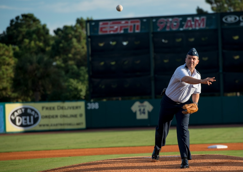 Col. Frederick Boehm, 437th Operations Group commander, throws the first pitch during the Charleston RiverDogs Military Appreciation Night game Aug. 21, 2013, at Joseph P. Riley Jr. park in Charleston, S.C. He was one of three commanders who threw the first pitch for the night. The Charleston RiverDogs hosted Military Appreciation night to show their support for the local military. (U.S. Air Force photo/Tech. Sgt. Rasheen Douglas)