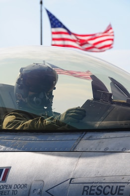 A 148th Fighter Wing F-16 pilot waits to get the go-ahead to taxi while participating in a Readiness Exercise in Duluth, Minn., July 20, 2013.  The Air Combat Command (ACC) Inspector General team evaluated the 148FW during a Readiness Inspection (RI), Aug. 22-24, 2013, the wing received an overall grade of excellent.   (U.S. Air National Guard photo by Master Sgt. Ralph J. Kapustka/Released)
