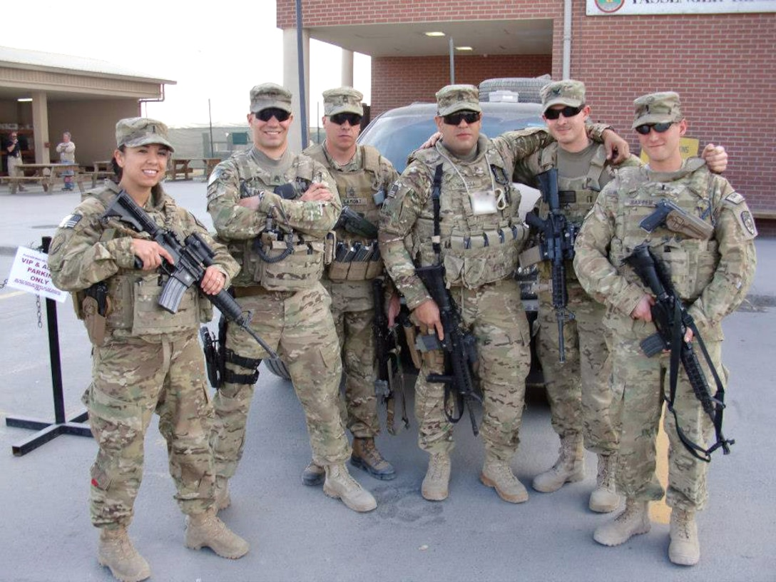 First Lt. Marcianna Pease poses for a photo with her fellow service members during her year-long deployment in Afghanistan as the biometric advisor to the Afghan Ministry of Interior. Pease is a 50th Operations Support Squadron Wideband Global SATCOM satellite instructor from Schriever Air Force Base. Pease was selected to be featured in the Built Schriever Tough campaign during the month of October 2013. See more of Schriever's Toughest at http://www.schriever.af.mil/builtschrievertough.asp or visit http://www.facebook.com/SchrieverAirForceBase to get involved. (Courtesy photo)