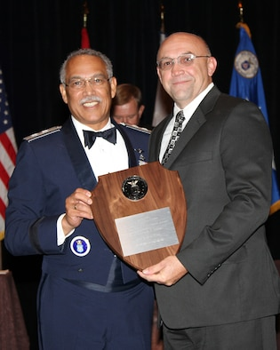 Maj. Gen Charles L. Carr, National Commander of CAP awards Michael E. Eckert a ground safety professional at the Air Force Safety Center the F. Ward Reilly Leadership Award at the Civil Air Patrol National Conference in Denver, Colo.  Aug. 15-17.