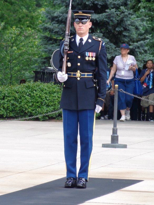 WRIGHT-PATTERSON AIR FORCE BASE, Ohio - Army Spc. Thomas Ozio, son of Chief Master Sgt. Shirley Ozio, 445th Logistics Readiness Squadron, and Staff Sgt. Daniel Ozio, 445th Civil Engineer Squadron, serves as a Sentinel at the Tomb of the Unknown Soldier, Arlington National Cemetery, Washington, D.C. (Courtesy photo)