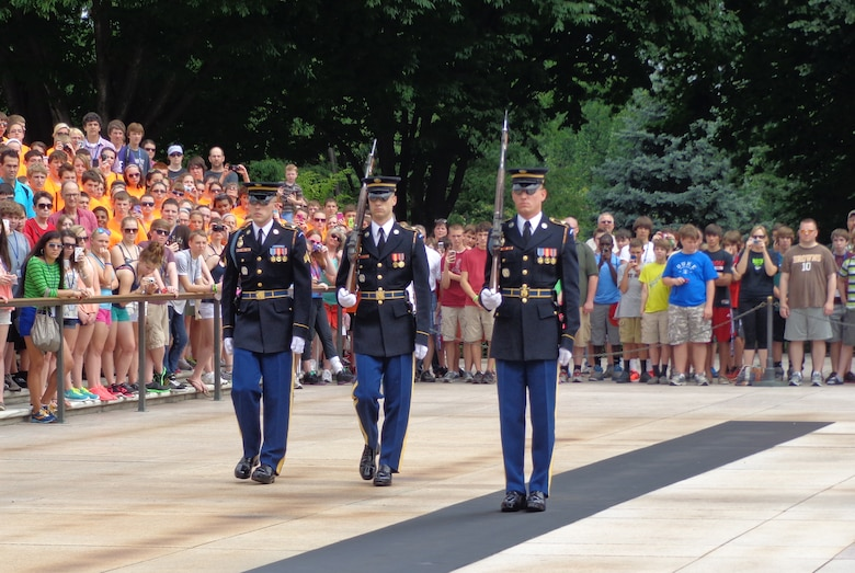 WRIGHT-PATTERSON AIR FORCE BASE, Ohio - (On the far right) Army Spc. Thomas Ozio, son of Chief Master Sgt. Shirley Ozio, 445th Logistics Readiness Squadron, and Staff Sgt. Daniel Ozio, 445th Civil Engineer Squadron, serves as a Sentinel at the Tomb of the Unknown Soldier, Arlington National Cemetery, Washington, D.C. (Courtesy photo)