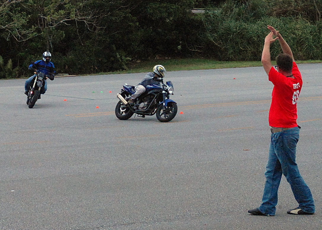U.S. Air Force Staff Sgt. Richard Ebert, Motorcycle Safety Foundation trainer from the 18th Communications Squadron, instructs during a military sport bike rider course, on Kadena Air Base, Japan, Aug. 20, 2013. The motorcycle training facility offers several basic rider courses a month, to include a monthly military sport bike rider's course and an advanced rider's course.  (U.S. Air Force photo by Staff Sgt. Lauren Snyder)