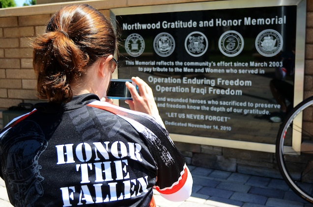 Jennifer Marino, a retired major, is cycling more than 2,700 miles, through 17 states, over the span of 77 days to meet with American Gold Star Mothers and their families in commemoration of service members killed in combat. One of Marino's stops is the Northwood Gratitude and Honor Memorial in Irvine, Calif. where she gathered rubbings of the names of several service members. She plans to hand deliver the names to some of the families she will visit as she crosses the country.