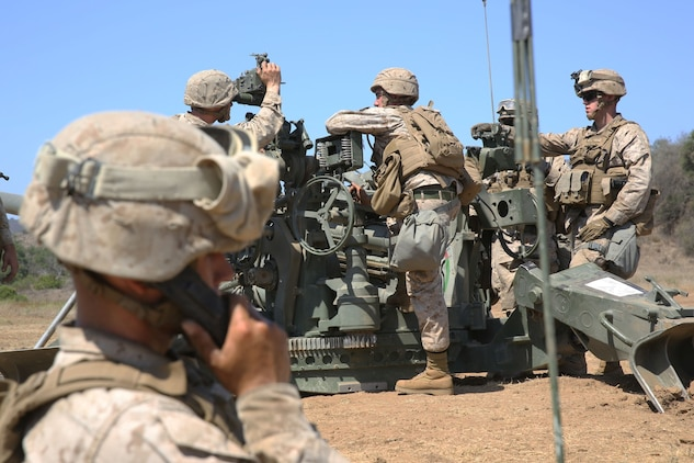 Marines serving with 1st Battalion, 11th Marine Regiment, adjust the elevation of an M777 Lightweight Howitzer during a 10-day artillery training exercise here, Aug. 23, 2013. Marines with the entire regiment conducted the live-fire training exercise from Aug. 19 through 28.