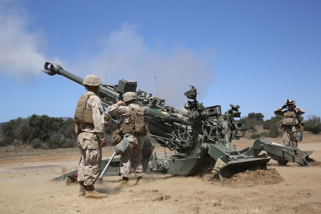 Marines serving with 1st Battalion, 11th Marine Regiment, fire an M777 Lightweight Howitzer during a 10-day artillery training exercise here, Aug. 23, 2013. Marines with the entire regiment conducted the live-fire training exercise from Aug. 19 through 28.