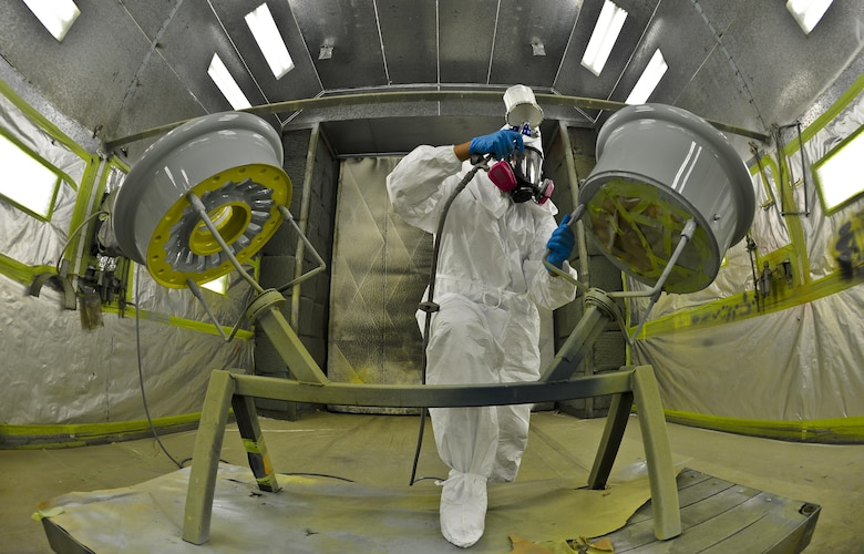 Airman 1st Class Eric Martinez, 6th Maintenance Squadron structures technician uses a newly designed wheel workstation to paint a KC-135 Stratotanker wheel, Aug 27, 2013 at MacDill Air Force Base, Fla. The implementation of the WWS reduced the paint process time by 26 hours per set.