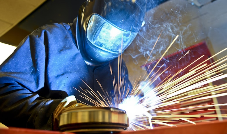 Staff Sgt. Alex Aguayo welds together a rotational plate he designed for a paint work station, Aug 22, 2013 at MacDill Air Force Base, Fla. Aguayo is one of two Airmen who co-engineered a way to centrifugally mount a KC-135's Stratotanker nose and main landing wheel on a rotating base, which reduces a wheel's paint process by 50 percent. Aguayo is an aircraft metals technician 6th Maintenance Squadron. (U.S. Air Force photo/Staff Sgt. Brandon Shapiro)