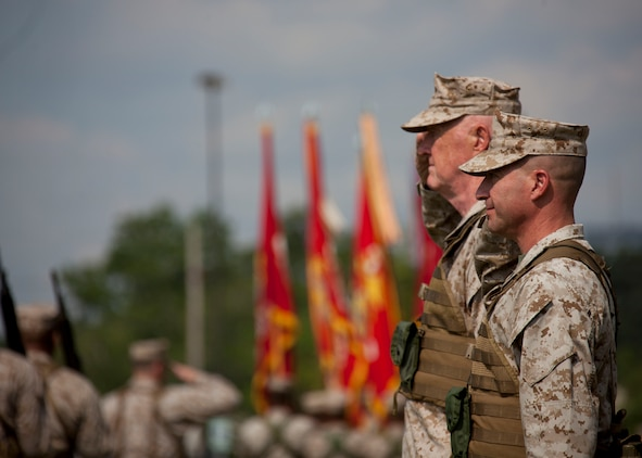Lt. Gen. Richard P. Mills, the commander of Marine Forces Reserve and Marine Forces North, and Sgt. Maj. Anthony A. Spadaro, the sergeant major of MARFORRES and MARFORNORTH, salute their Marines during the pass-in-review at the MARFORRES assumption of command and appointment ceremony aboard Marine Corps Support Facility New Orleans, Aug. 28, 2013. Mills is taking charge of the largest command in the Marine Corps, encompassing more than 100,000 Marines at more than 160 sites in 47 U.S. states, Guam and Puerto Rico.