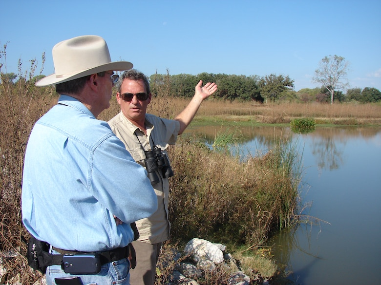 Gary Dick of ERDC's Lewisville Aquatic Ecosystem Research Facility discusses the Lower Chain of Wetlands with Ken Klaveness of Trinity Waters.