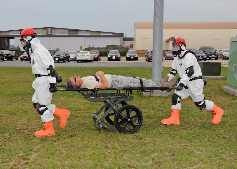 Members of the 143d Airlift Wing involved in the Region 1 Chemical, Biological, Radiological, Nuclear, High Yield Explosive Enhanced Response Force Package (CERFP) perform a training exercise to demonstrate the team's responsibilities and capabilities to potential new members and leadership. Colonel Arthur Floru (on stretcher),143d AW commander volunteered to play a victim for the exercise. The Region 1 CERFP is made up of members of the Air and Army National Guard from Maine, New Hampshire, and Rhode Island. National Guard Photo by Master Sgt Janeen Miller (RELEASED)