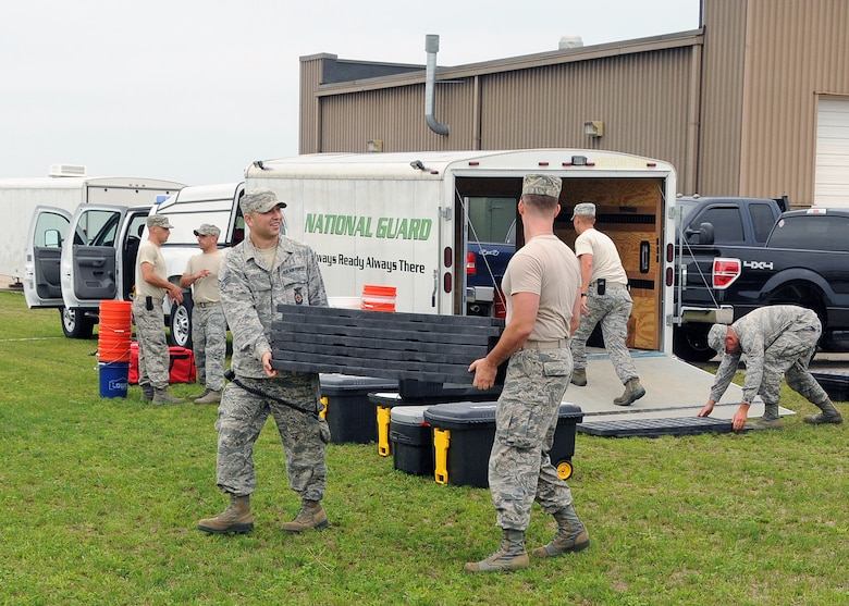 Members of the 143d Airlift Wing involved in the Region 1 Chemical, Biological, Radiological, Nuclear, High Yield Explosive Enhanced Response Force Package (CERFP) perform a training exercise to demonstrate the team's responsibilities and capabilities to potential new members and leadership. The Region 1 CERFP is made up of members of the Air and Army National Guard from Maine, New Hampshire, and Rhode Island. National Guard Photo by Master Sgt Janeen Miller (RELEASED)