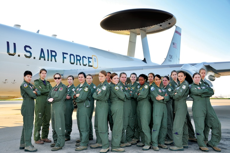 Airmen with the 552nd Air Control Wing and 513th Air Control Group pose for a photograph prior to making an historic all-female flight on Aug. 23. (Air Force photo by Darren D. Heusel)