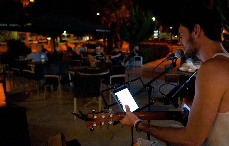 James Miller sings to an audience at open mic night Aug. 6, 2013, at Incirlik Air Base, Turkey. Open mic night occurs Tuesday nights outside of the Incirlik club complex. (U.S Air Force photo by Senior Airman Daniel Phelps/Released)