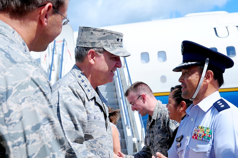 Air Force Chief of Staff Gen. Mark A. Welsh III is greeted by Lt. Gen. Tetsuo Morimoto, Northern Air Defense Force commander, upon his arrival to Misawa Air Base, Japan, Aug. 28, 2013.  During Welsh's visit, his first to Misawa as the CSAF, he toured various locations on base and met with hundreds of Misawa Airmen.