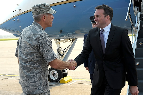 Acting Secretary of the Air Force Eric Fanning shakes hands with Lt. Gen. Brooks Bash, Air Mobility Command vice commander, during a visit to Scott Air Force Base, Ill., Aug. 22, 2013. During his visit, he spoke with Airmen about their concerns and explained future policies taking place in our nation's capital.