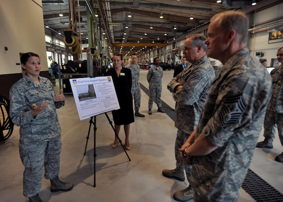 Capt. Elizabeth Hoeltje (left) briefs Chief Master Sgt. of the Air Force James A. Cody and Air Force Chief of Staff Gen. Mark A. Welsh III  Aug. 23, 2013, at Osan Air Base, South Korea. Welsh and Cody spent two days at Osan AB during their first visit to the Pacific Air Forces. Hoeltje is a sustainment flight chief with the 51st Force Support Squadron. (U.S. Air Force photo/Senior Airman Siuta B. Ika)