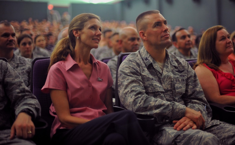 Col. Brook Leonard (right) and his wife Maria, listen to Air Force Chief of Staff Gen. Mark A. Welsh III and Chief Master Sgt. of the Air Force James A. Cody speak during an Airman's call Aug. 22, 2013 at Osan Air Base, South Korea. Welsh and Cody thanked Airmen for their continued service and dedication, and issued their three keys to success: common sense, communication and caring. Leonard is the 51st Fighter Wing commander.