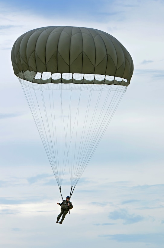 Staff Sgt. Daniel Guy makes his way to the ground Aug. 21, 2013 after jumping from a C-130 Hercules over Andersen Air Force Base, Guam. Air Force static line capability falls under the personnel parachute program. Jumpers are first qualified during a three-week long basic airborne course at Ft. Benning, Ga., and then continue to work on their jumping proficiency and qualifications after they return here. Guy is the 736th Security Forces Squadron fire team leader (U.S. Air Force photo/Airman 1st Class Marianique Santos)