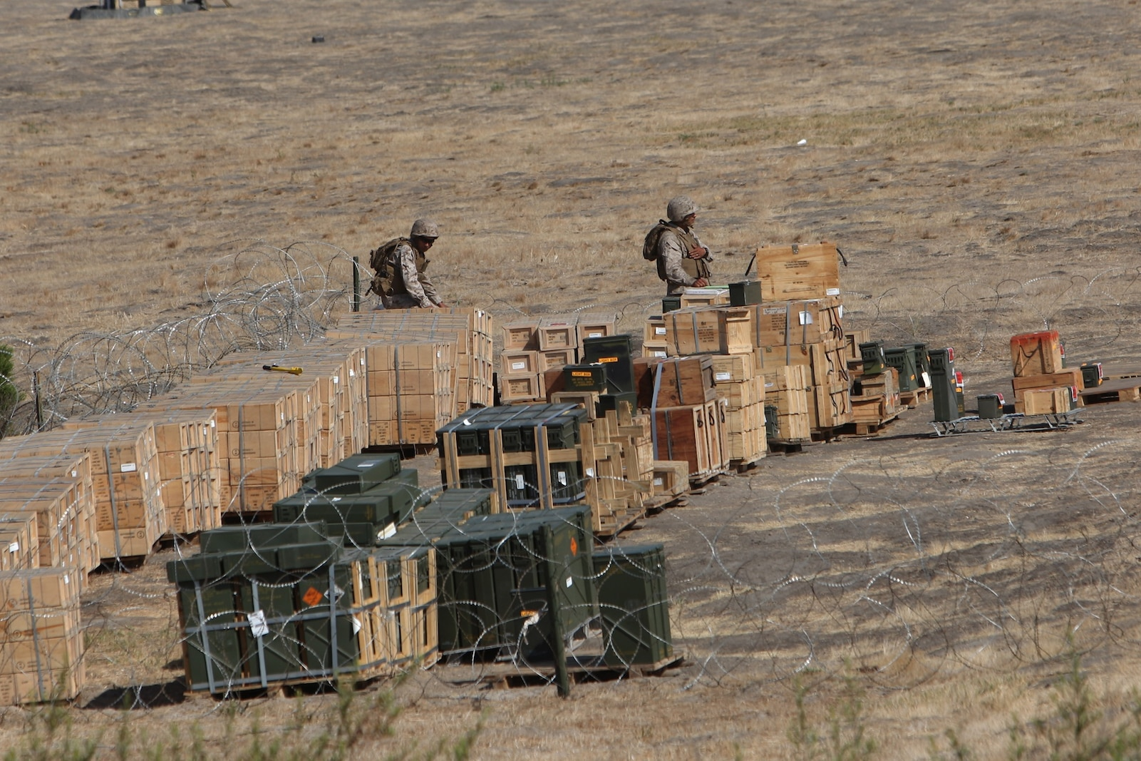 Marines with 1st Supply Battalion, Combat Logistics Regiment 15, 1st Marine Logistics Group, stage ammunition during an ammunition resupply exercise aboard Camp Pendleton, Calif., Aug. 23, 2013. From Aug. 16-30, 1st Supply Bn. is expected to transport approximately 100,000 pounds of ammunition in support of exercises conducted by the 11th Marine Regiment, 1st Marine Division.