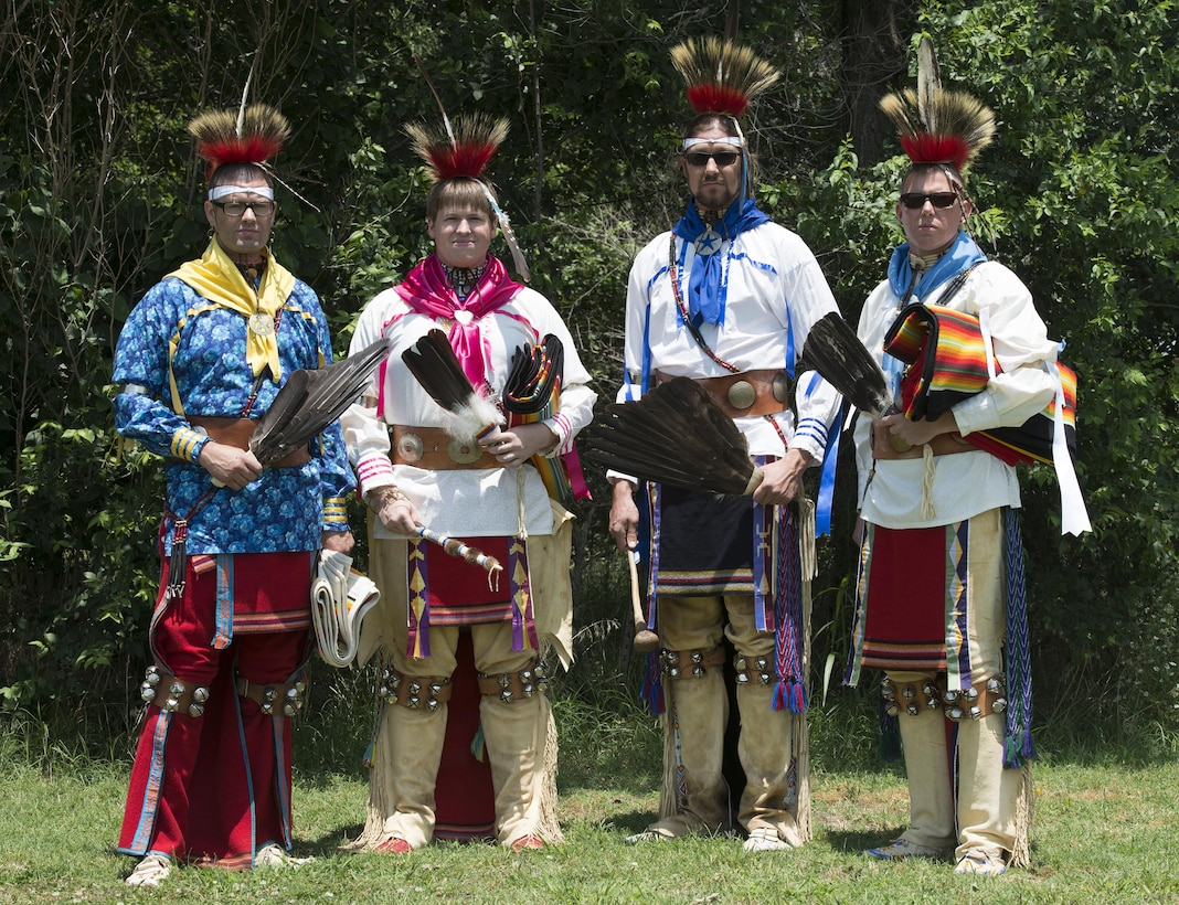 Osage Nation relatives of Maj. Gen. Clarence L. Tinker, dressed in native attire, sing and dance to a song written to Tinker during their annual four day celebration called In-lon-shka held in Pawhuska Indian Village, Okla., June 30, 2013. Tinker was the highest ranking officer of Native-American ancestry and the first general lost in action during World War II.