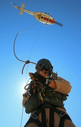 Navy Seaman Curt Hansen, a search and rescue medical technician with Headquarters and Headquarters Squadron and a native of Burlington, Ky., readies a hoist and litter carry during a routine training exercise conducted at Ledge on the River, just northeast of Marine Corps Air Station Yuma, Ariz., Thursday.