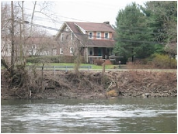 The project consists of bank stabilization of the right bank of the Schuylkill River along River Road between Laurelwood Road and the Hanover Street Bridge. A short section of the steep, eroding right bank of the Schuylkill River along River Road in North Coventry Township is shown in the picture. The total project length is 1200 feet in two reaches.