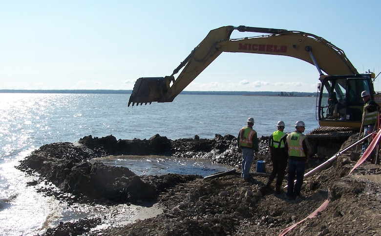 Contractors working on the Cat Island Restoration Project in Green Bay, Wis. excavate a trench for the reinforced concrete pipe, RCP, (culvert) for water flow between the islands.