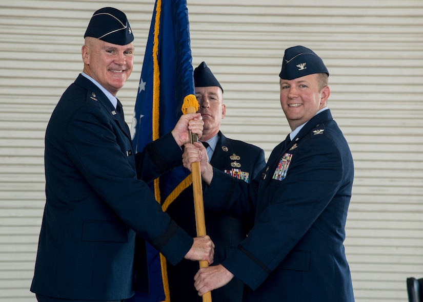 Brig. Gen. Randall Guthrie, U.S. Air Force Expeditionary Center commander, passes the guidon to Col. Jeffrey DeVore during the JB Charleston Change of Command ceremony, Aug. 29, 2013, at JB Charleston – Air Base. DeVore, previously the commander of the 386th Expeditionary Operations Group, Southwest Asia, officially assumed command from Col. Richard McComb  during the change of command ceremony. McComb will be assuming duties at the Pentagon, Washington D.C. As the JB Charleston commander, McComb provided installation support to a total force of more than 86,000 Airmen, Sailors, Soldiers, Marines, Coast Guardsmen, civilians, dependents and retirees across both the Air Base and Weapons Station. (U.S. Air Force photo/Tech. Sgt. Rasheen Douglas)
