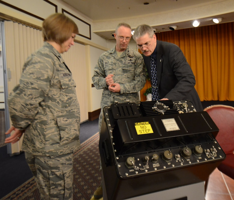 Col. Michael Kelly, Electronic Warfare and Avionics Division chief and John Miller, Agile Combat Support director, view a Joint Service Electronic Combat Systems Tester Tuesday during a reception at the Horizons Event Center. (U.S. Air Force photo by Tommie Horton)