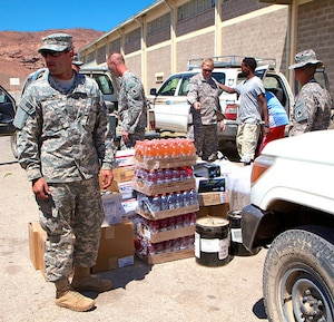Soldiers from the 2/138th Field Artillery Regiment met at the border of Djibouti and Ethiopia to exchange supplies for the troops deployed to Camp Gilbert, Ethiopia.
