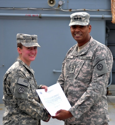 Spc. Erin Colburn receives a letter of conditional acceptance to West Point by Lt. Gen. Vincent K. Brooks, commanding general of Third Army/ARCENT.
