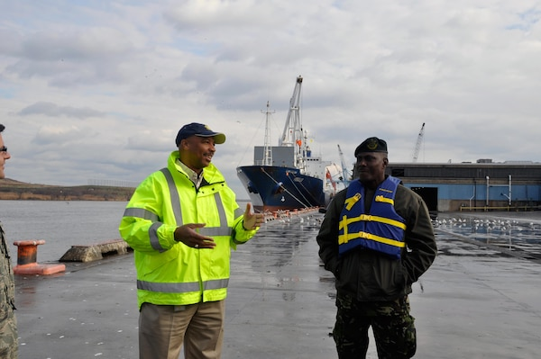 Port of Wilmington security manager Jerry Custis discusses security measures at the port with Col. Rodney Smart, chair of the Trinidad and Tobago Energy Sector Security Initiative.