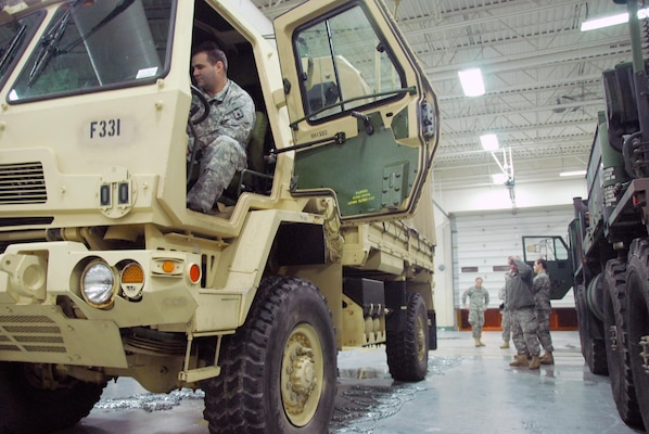 A Soldier at the Sussex, Wis., National Guard armory readies a light medium tactical vehicle for use during a major snowstorm that hit Wisconsin on Dec. 19, 2012.