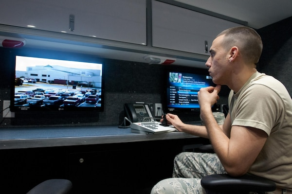 Kentucky Air National Guard Senior Airman Eric Finley, an emergency manager for the 123rd Civil Engineer Squadron, operates a surveillance camera in the unit's new Mobile Emergency Operations Center in Louisville on Dec. 1, 2012.