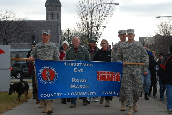 New York Army National Guard Soldiers, families, friends and supporters from the community march in the the 9th annual Christmas Eve road march in Glens Falls, N.Y., Dec. 24, 2012.