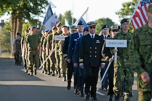 The U.S. Orienteering Team marches in at the opening ceremonies of the 2013 CISM Orienteering World Military Championship hosted by the Swedish Armed Forces in Eksjo, Sweden 26 Aug-1 Sep.