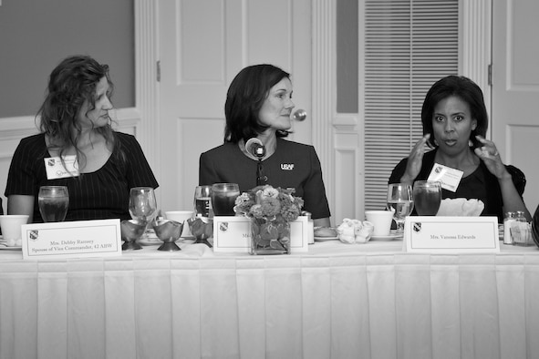 Vanessa Edwards, right, wife of Col. Trent Edwards, 42nd Air Base Wing commander, discusses the future of the Key Spouse Program during a luncheon with Debby Ramsey, left, wife of Col. Mark Ramsey, 42nd ABW vice commander, and Betty Welsh, center, wife of Gen. Mark Welsh, Air Force chief of staff, along with other commanders, first sergeants, key spouse mentors, key spouses and representatives from the Airman and Family Readiness Center.(U.S. Air Force photo by Donna L. Burnett)